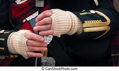 Hands Playing The Bagpipes - Closeup of mans hands...