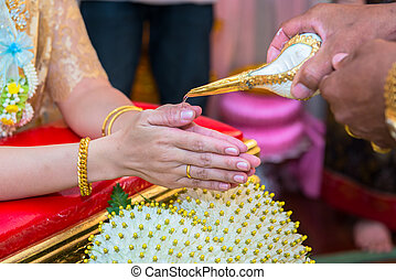 hands pouring blessing water