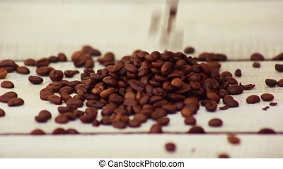 Hands pouring coffee beans