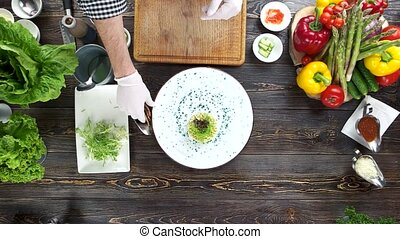 Hands preparing food, table. Vegetable tartare and toasts.