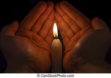 Hands protecting a Candle