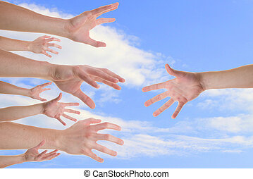 Hands reaching for a helping hand
