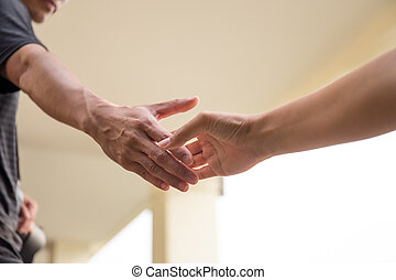 Hands reaching out to help together - Help Concept Hands...