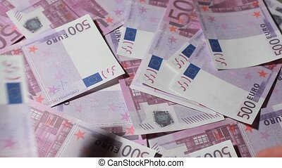 Hands recount souvenir banknote five hundred euros on pile...