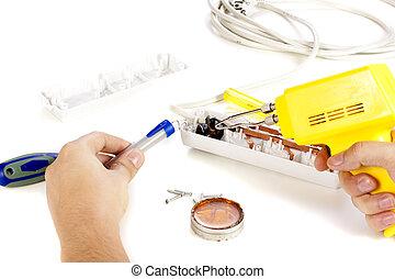 Hands repairing extension cord