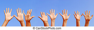 Hands - Row of hands with open palms on blue sky background