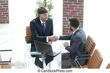 hands shake between two successful business people