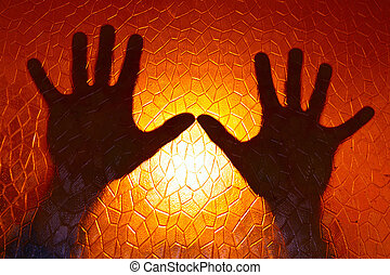 Hands Silhouette on Fire Orange Color Background stained glass with geometric pattern Horror Cinematic and concept of Phobia and Depression Emotion