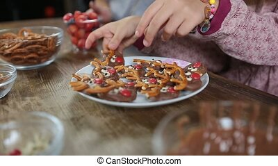 Hands taking homemade cookies from the plate