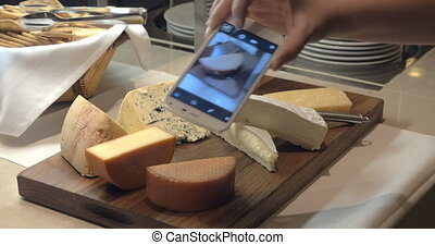 Hands Taking Photo Pieces Of Cheese
