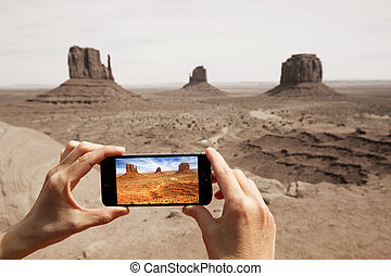taking picture at the monument valley