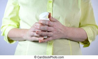 Hands taking pills