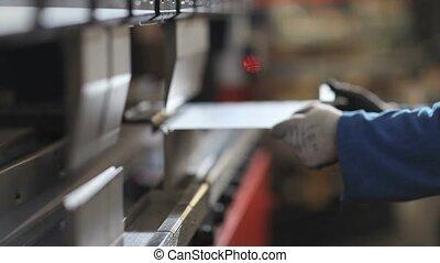 hands that bend sheet metal worker