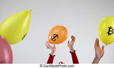 Hands throw up balloons with cryptocurrency logo. Colorful air balloons with icons of cryptocurrency and human hands.