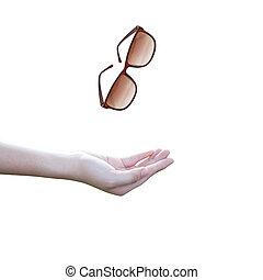 throwing eyeglasses - Hands throwing eyeglasses on white...