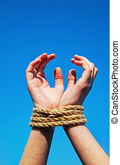 Hands tied up with rope