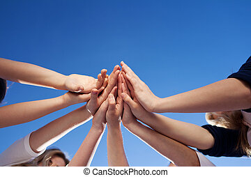 Hands Together Against Clear Blue Sky