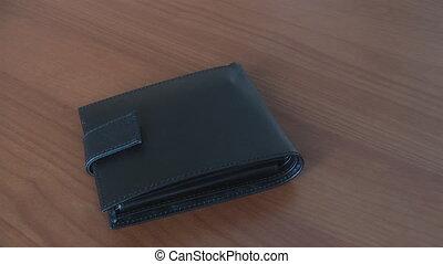 hands turn inside an empty wallet