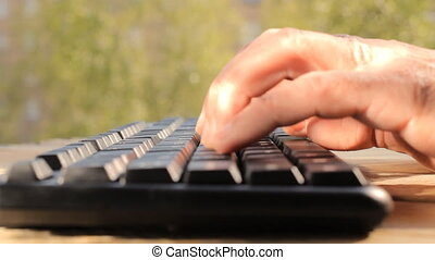Hands typing on keyboard, close-up