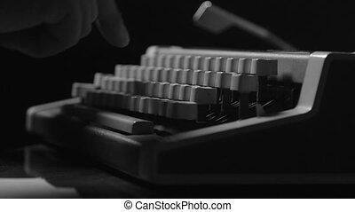 Hands typing on typewriter