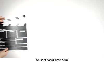 Hands use movie clapper board, on white, slow motion - Hands...