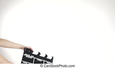 Hands use movie production clapper board, on white, slow...