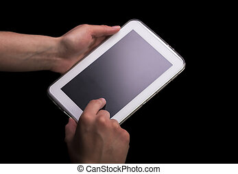 Hands Using a White Tablet Computer on Black Background