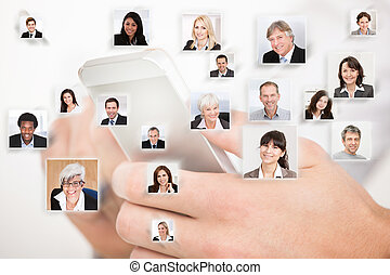 Hands Using Cell Phone Representing Global Communication