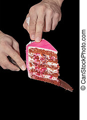 Hands waiter serves a piece of fruit cake in pink glaze on a family celebration-wedding, birthday. Isolated on black background