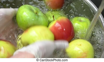Hands washing apples. Clean fruit close up.
