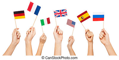 Hands waving flags of USA and EU member-states - Hands...