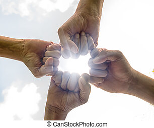 Hands were a collaboration concept of teamwork with sun