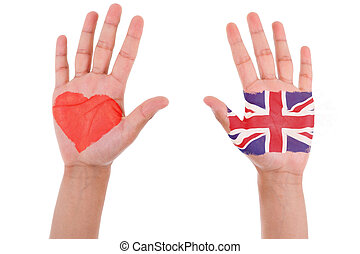 Hands with a painted heart and united kingdom flag, i love uk concept, isolated on white background