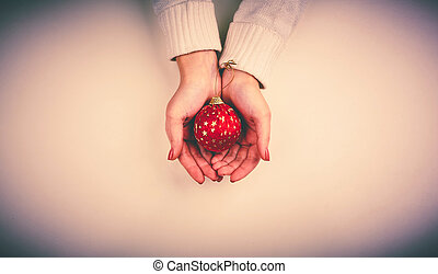 Hands with bauble