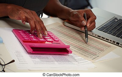 Hands with calculator.