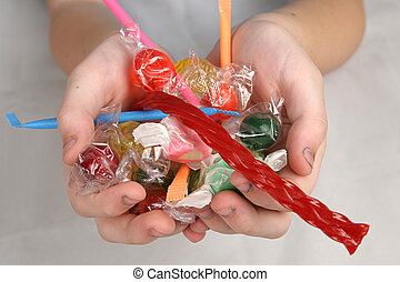 Hands with Candy - A closeup of a child\'s hands filled with...