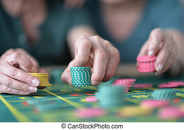 hands with casino chips