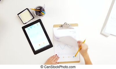 hands with clipboard and chart on tablet computer - business...