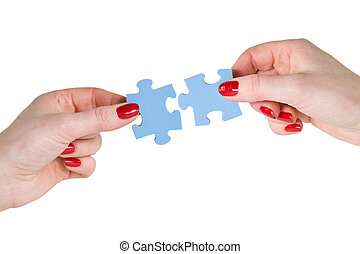 hands with different pieces of puzzle