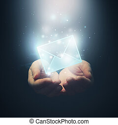 Hands with envelope. E-mail, global communications, mail or contact us concept. Selective focus on fingers.