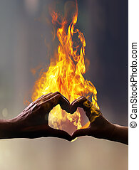 hands with fire in form of heart