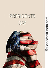 hands with flag of US and text presidents day - the clasped...