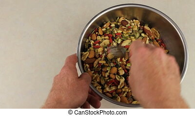 Hands With Fork Mix Nuts and Fruits - Adult male hands...