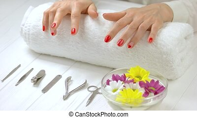 Hands with fresh manicure in spa salon. Well-groomed hands...