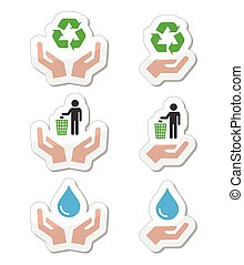 Hands with green, ecology symbols