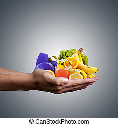hands with healthy, natural foods, juice and weights for ...
