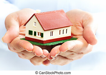 Hands with little house. - Hands holding Family house model....