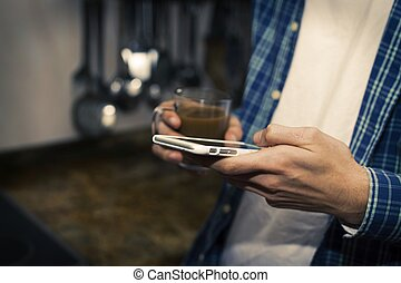 hands with mobile phone and coffee cup