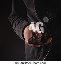Hands with mobile phone in 4G LTE network, wireless...