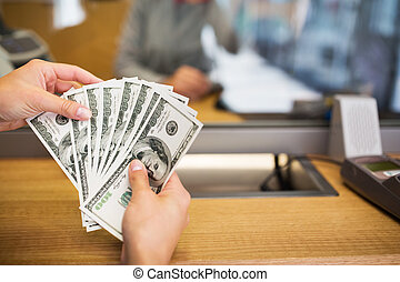 hands with money at bank office or exchanger - people,...